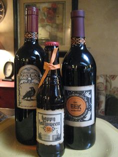 Here are two wine bottles and one beer covered with the labels, aren't ...