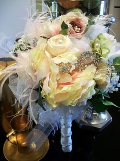Custom brooch bouquet with feathering by Jannyfays on Etsy, $80.00