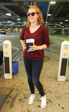 Jessica Chastain from The Big Picture: Today's Hot Pics  Lady in red! The actress arrives at Miami International Airport.