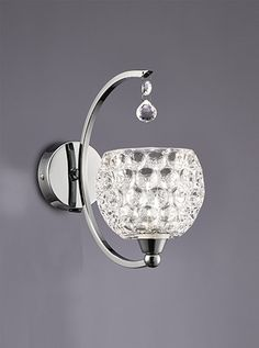 FL2339/1 Omni 1 light wall light Chrome Finish with Dimpled Glass Shades Switched on the Base with a rocker switch Supplied with G9 mains voltage halogen lamps which are suitable for dimming. 1 x 33w G9 Lamps Included Height 20cm Width 36cm Projection 17 cm BRAND: Franklite REFERENCE- FL2339/1 AVALIABILITY- 3-4 Working Days