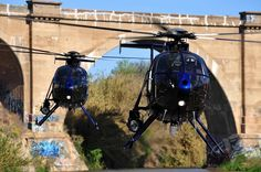 Two Riverside (California) Police Department MD 500E helicopters fly together during a two-ship training flight. Photo by Skip Robinson