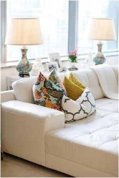pillows in varying patterns / scales