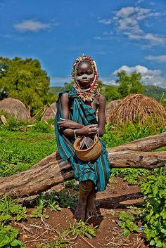 Mursi tribe boy with his face painted, Mago National Park, Omo Valley, Ethiopia