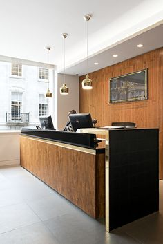 The Clubhouse reception, slightly cold but love the use of materials and simplicity of reception desk...sleek use of chrome