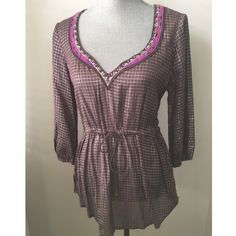 ✨ Free People Deep V-neck top This boho top has an amazing fit! Would be perfect with dark/light denim! Has a drawing string tie at the waist. Beautiful colors in person! Excellent condition. Never worn. NWOT. Free People Tops
