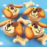 Puppy Dog Cupcakes - These are so flippin' easy.  Just buy boxed cake mix and premade frosting, then decorate!  So cute =)
