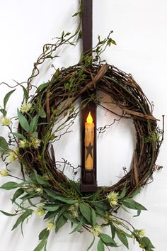 Eucalyptus blossoms, primitive country wreath, with electric candle. Perfect for Imbolc. (You could use other flowers that are more appropriate for Imbolc.)
