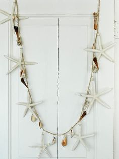 More adventurous beachy garland ~ you can buy this or make it yourself...... making it is more fun and more personal ~ a great reminder of a day at the beach if you string your beach finds onto a garland!!!