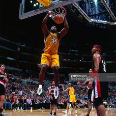 Shaquille O'Neal #34 of the Los Angeles Lakers dunks the ball against the Portland Trail Blazers on January 22, 2000 at Staples Center in Los Angeles, CA.