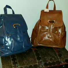 J Francis Brown faux leather backpack 12x5x13 the beautiful look of leather in a caramel or blue at just a fraction of the cost of real leather be stylish and hands-free  with this gorgeous backpack. J Francis   Bags Backpacks