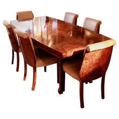An Art Deco, walnut veneered dining table with six chairs by Hille. Refurbished, re-polished and re-upholstered in cream leather. Dimensions: H L W Chair: Seat W seat D seat H seat back H Origin: English, circa 1935 Item no: Walnut Dining Table, Dining Table Chairs, Table Furniture, Dining Room Suites, Cherry Hardwood Flooring, Walnut Veneer, Upholstery, Art Deco, Tapestries