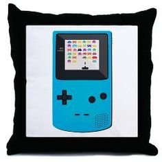 Old School Hand Held Throw Pillow    This Old School Video Game graphic product is a great video game design. Awesome for a video game enthusiasts. It has a old school Hand Held game system with a old school game being played.
