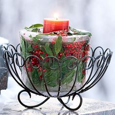 Icy Holly-and-Cranberry Candleholder: Ice cream bucket filled with various xmas decorations: FREEZE! Magic!