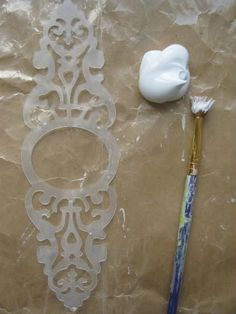 mixed Media Tutorials - Gesso :: building texture onto collage creations.