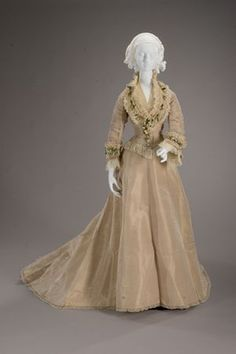 Wedding dress, by I.W.Caley, 1875, silk satin, orange blossoms, silk net with cotton petticoat.