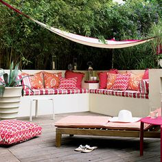 Basic idea for patio seating - bench seats lift up for pillow & cushion storage. Waterproof cushions are a must!