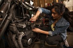 View top-quality stock photos of Female Mechanic In Workshop Using Digital Tablet. Find premium, high-resolution stock photography at Getty Images. Lady Biker, Biker Girl, Taxi Driver, Motorcycle Mechanic, Motorcycle Garage, Woman Mechanic, New Motorcycles, Digital Tablet, Character Inspiration