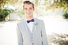Great light colored suit with polka dot bowtie!