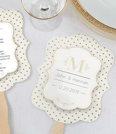These classic gold-dot handfans can double as a menu at the reception, or a program at the wedding ceremony! Totally affordable, they're also cute for complimenting decor of a white, black and gold wedding.