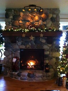 The Coulter christmas river rock fire place mantel