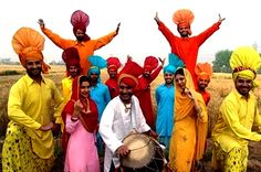 Punjabi girls and boys dancing to the tunes of Bhangra in the fields