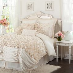 Four-piece ruffled comforter set in ivory.     Product: 1 Queen comforter, 1 bedskirt and 2 standard pillow shams  C...
