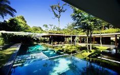 Clunny House, A Sustainable Modern Home Design with Inner Tropical Water Garden by Guz Architects