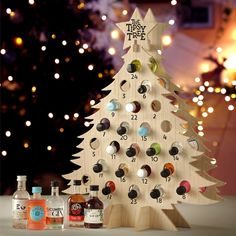 bottles of flavoured gin and gin liqueur in this adult advent calendar - a gin advent calendar, perfect for Christmas gift. Alcohol Advent Calendar, Craft Beer Advent Calendar, Adult Advent Calendar, Advent Calendar Fillers, Christmas Tree Advent Calendar, Advent Calendars For Kids, Advent Calenders, Diy Calendar, Advent Wreath Candles