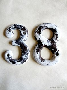How to get this distressed look with water.  Distressed metal numbers
