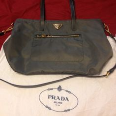 Authentic Prada Cross Body Bag Authentic Prada Nylon Gray 2way Bag in great condition . With a small dot as seen on pic. Not really noticeable . Very clean inside and out. No damage. Can be used as a shoulder or cross body bag. Comes with dust bag. Will trade with an LV bag. TV $900. Prada Bags Crossbody Bags