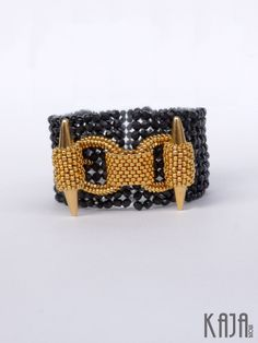Cuff w interesting use of spike beads on toggle bar