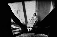 Trent Parke. AUSTRALIA. Sydney. A blind woman sings for her sight as a couple holding hands walks past. Circular Quay. From Dream/Life series. 1999.
