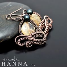 These flirty wire wrapped copper earrings measure just 3 cm in length and feature a softly faceted citrine stone with a bottle green freshwater pearl accent. The copper wire is hand woven and wrapped to form a bow tie at the base. Ear wire is pure copper and safe for nickle-sensitive ears.   US...