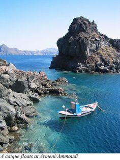 A caique floats at Armeni/Ammoudi - Oia  Santorini