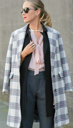 ivory grey blush long plaid coat, blush pink tie bow neck blouse, high-waisted pleated grey wool pants, long black vest, classic black ankle strap pumps + silver choker