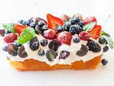 Make It Fancy: Fruit and Whipped Cream : Take your poke cake to the next level of fanciness by decorating the top with berries, whipped cream and mint leaves, then dust with a bit of confectioners' sugar.