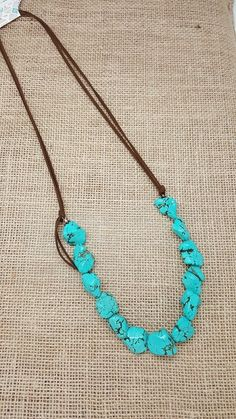Stunning turquoise stone necklace with leather chain. Handmade