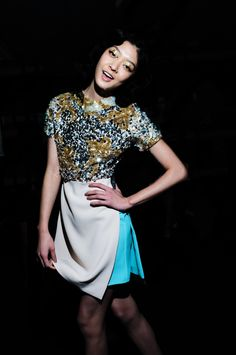 Gold sequins stand out against a colour-blocked skirt & even adorn the eyes. Shine on. Michael van der Ham AW12.