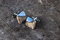 Check out this item in my Etsy shop https://www.etsy.com/listing/521141043/wooden-cufflinks-square-wood-with-resin