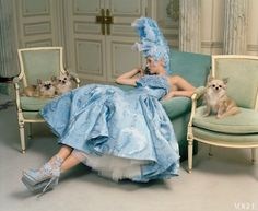 Kate Moss at the Paris Ritz with some long-haired chihuahuas.