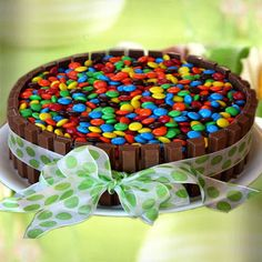 This Kit Kat Cake recipe begins with chocolate cake. It's surrounded by Kit Kat Candy Bars, wrapped with a ribbon and topped with M&M's. Food Cakes, Cupcakes, Cupcake Cakes, Despicable Me Cake, 1st Birthday Cake For Girls, Rainbow Layer Cakes, Easy Cakes To Make, Mousse Cake, Cakes For Boys