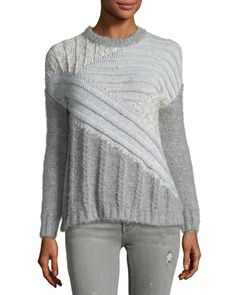 Current/Elliott textural sweater in mixed, directional cable knits. Ribbed crew neckline, cuffs, and hem. Slightly chunky silhouette. Pullover style. Alpaca/wool/nylon. Dry clean. Imported.