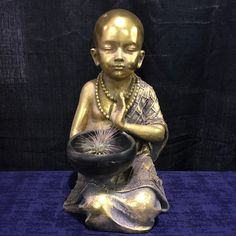 A personal favorite from my Etsy shop https://www.etsy.com/listing/606170832/kneeling-buddhist-monk-with-begging-bowl