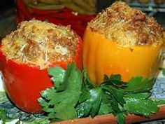 Bell Peppers stuffed with rice, ground beef, and jack cheese~making tonight with ground venison......we shall see. No ketchup though~