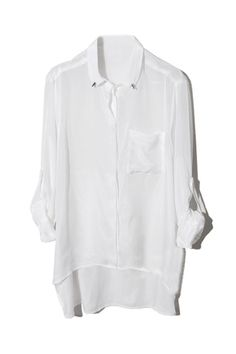 Asymmetric Rivets Embellished Lapel White Shirt. Description This white chiffon shirt featuring unique lapel with rivets embellishment,long sleeves with one button decorative cuffs,single-breasted design,asymmetric hem with short front and long back. Fabric Chiffon. Washing Cool hand wash with similar colours, do not tumble dry. #Romwe