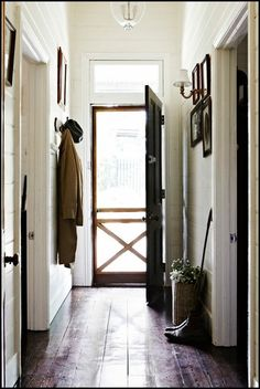 An old-fashioned screen door.  The simplicity of a narrow entry hall.