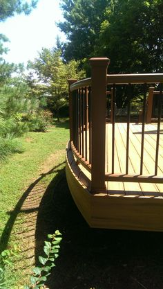 Curved Trex Transcends Railing in Treehouse. The curved deck is made of Tiki torch.