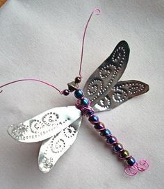 Punched tin, beads, and wiring make this beautiful dragonfly ornament. can be made from pop cans also ~ could be a lapel pin as well. Tin Can Art, Soda Can Art, Tin Art, Wire Crafts, Metal Crafts, Jewelry Crafts, Soda Can Crafts, Fun Crafts, Arts And Crafts