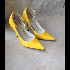 Yellow Patent Leather Heels You'll need your sunnies when you wear these bright yellow heels from Dollhouse.   HIGH heels, cute ankle strap buckle detail and bright color make these sassy saffron heels a must. Gently worn inside, very slight crease across toes (see third pic) and tiniest worn spot on back left heel - priced accordingly. Dollhouse Shoes Heels