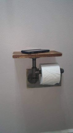 """Industrial Toilet Paper Holder, Farmhouse Toilet Paper Holder, Plumbing Pipe Toilet Paper Holder, Industrial Bathroom, Rustic - with Shelf - Constructed of ½"""" iron pipe made from unfinished fittings with a natural gunmetal color. Industrial Toilets, Industrial House, Industrial Farmhouse Decor, Industrial Pipe Shelves, Plumbing Pipe Shelves, Plumbing Pipe Furniture, Shelves With Pipes, Industrial Lamps, Rustic Shelving"""